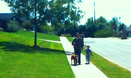 Father and Son Walking Dog